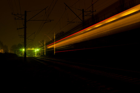 Lights on the railroad train of the night city.