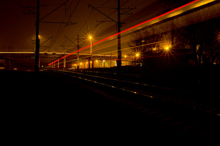 Lights on the railroad train of the night city. Stock Photo