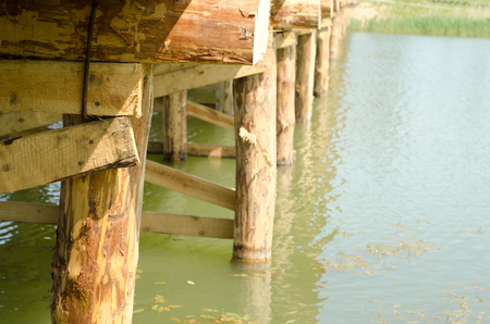 by cu: Wooden bridge over the river by CU Stock Photo