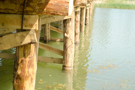 Wooden bridge over the river by CU Stock Photo