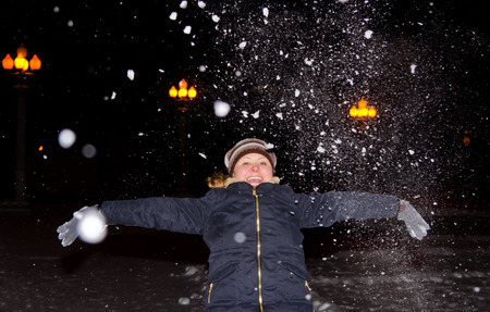 armful: Girl throws up an armful of snow