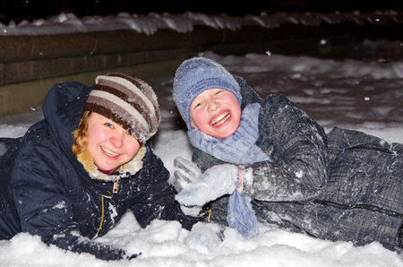 Mother and son playing in the snow Stock Photo