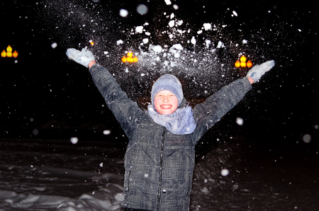 Boy throws up an armful of snow