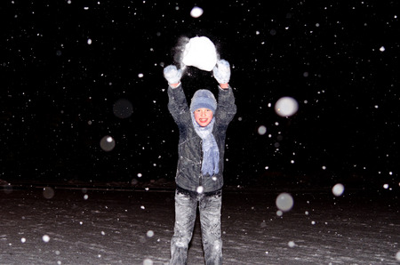 Boy throws a snowball Stock Photo