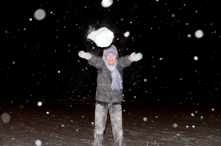 snowball: Boy throws a snowball Stock Photo
