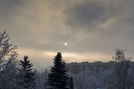Winter sun over the snow-covered city