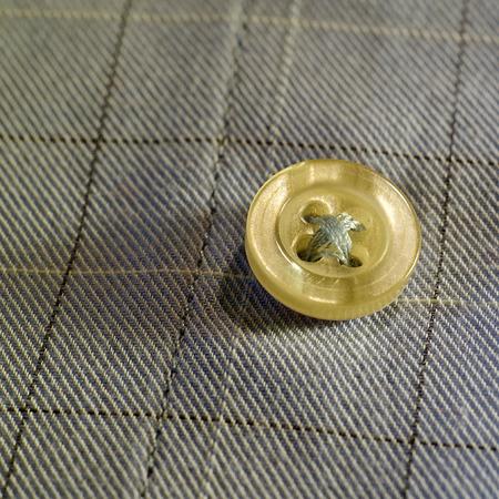 Sewn a button on a shirt
