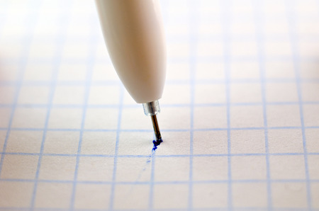 Macro pen on a sheet of paper in the box Stock Photo