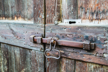 deadbolt: deadbolt on old wooden door Stock Photo