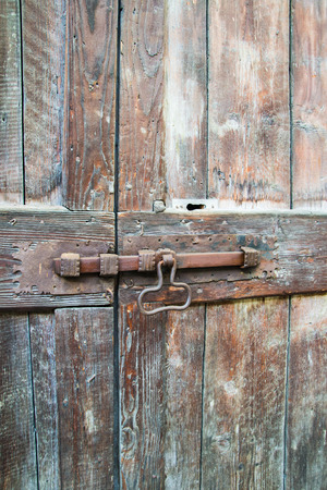 deadbolt on old wooden door photo