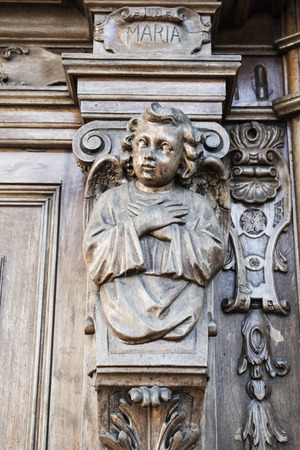 portal: angel carved in a wood portal