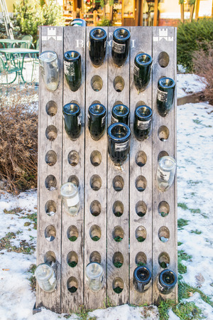 responsibly: empty wine bottles out of a pub