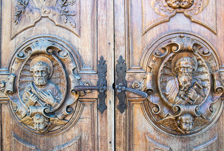carved wooden portal of an italian church photo
