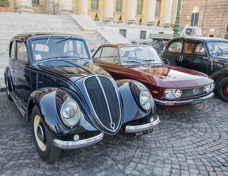 proceeds: VERONA, ITALY - JANUARY 6: Classic vintage cars. Benaco Classic Autoclub organizes a gathering called witch of the policeman on Verona Tuesday, January 6, 2015. The proceeds are donated to charity.