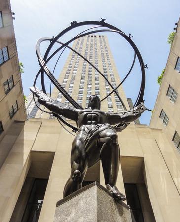 NEW YORK - JUNE 18: Atlas Statue at Rockefeller Center on June 18, 2014 in New York. The Atlas Statue is a bronze statue in front of Rockefeller Center in midtown Manhattan, New York City.