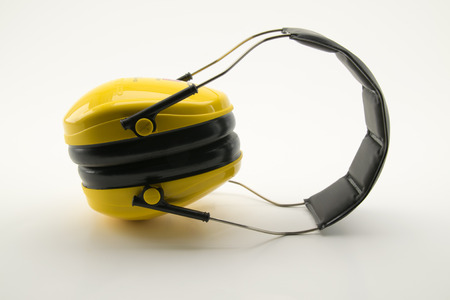 decibels: yellow ear protection, safety devices Stock Photo