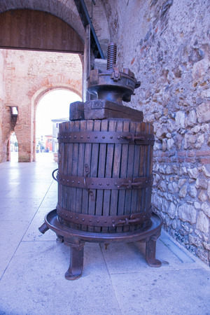 winepress: old wooden manual press used to press the grapes and make wine in Italy