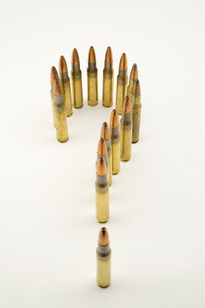 gun shell: composition with bullets positioned as a question mark