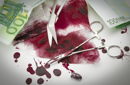 Surgical composition with bullets, blood, bandage and money photo