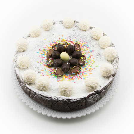 chocolate eggs: Easter cake with ricotta and chocolate decorated with chocolate eggs and powdered sugar Stock Photo