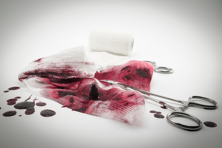 dissection: Surgical composition with bullet, blood and bandage Stock Photo