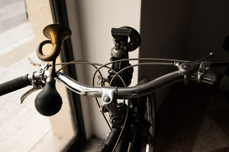 horn like: handlebar with horn like a trumpet and acetylene headlight of a vintage moped Stock Photo