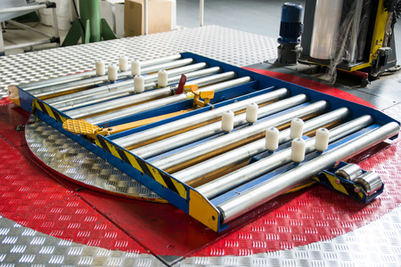 lean machine: Turntable for wrapping pallets with stretch film Stock Photo