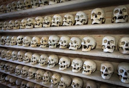 eye socket: human skulls inside a Christian catacomb