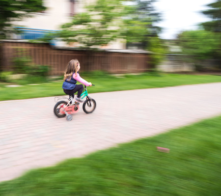 casters: little girl ride fast on bike with casters
