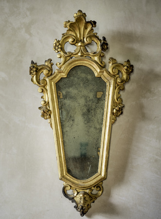 antique mirror: classic antique mirror with gilded frame engraved Stock Photo