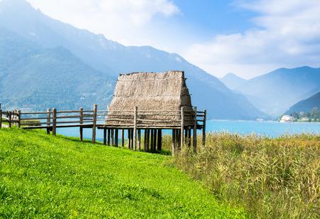 paleolithic: paleolithic piledwelling near Ledro lake in north Italy Stock Photo