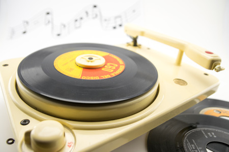 composition with vintage record player and old records photo