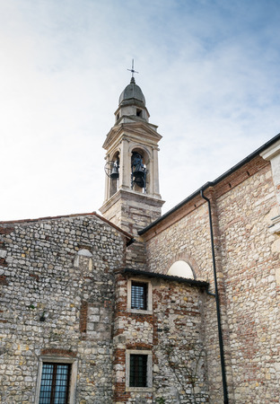 bell tower: ancient bell tower in a medieval village in Italy