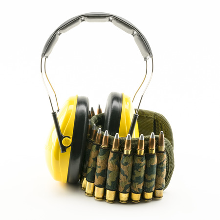 ammunition: yellow ear protection and camouflage ammunition belt for rifle