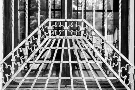 iron barred: grate of a window of an ancient monastery