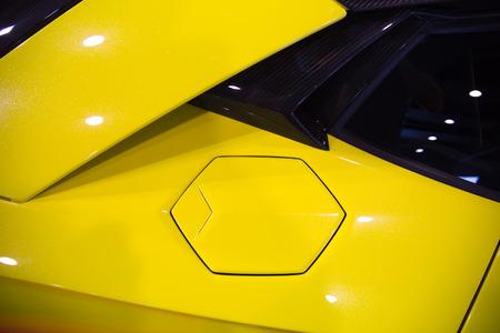 sportscar: hexagonal fuel cap of a yellow sportscar