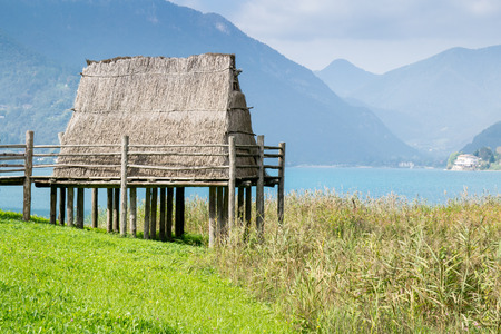 lake dwelling: paleolithic pile-dwelling near Ledro lake, site in north Italy Stock Photo