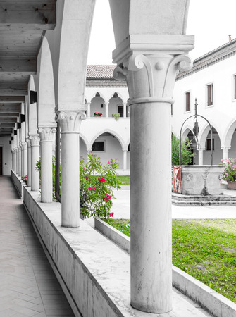 cloister: rectangular cloister with Gothic arches and marble columns. Stock Photo