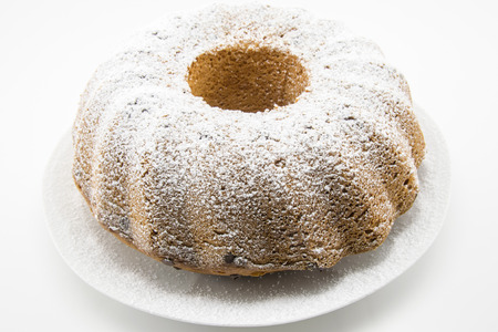 classic italian cake with icing sugar and hole in the center Фото со стока