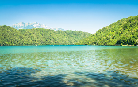 lake beach: Levico Lake, one of the most beautiful lakes in Italy. Stock Photo