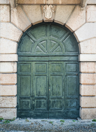 portal: carved wooden portal of an italian palace Stock Photo