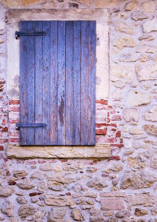 balcony window: Ancient stone window with old wooden balcony Stock Photo