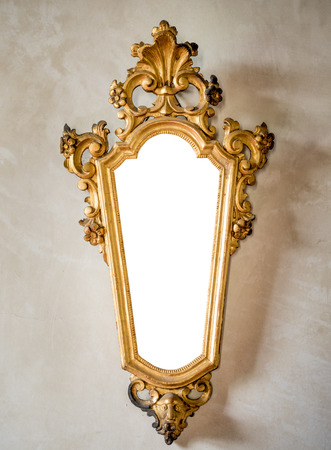 antique mirror: classic antique mirror with gilded frame engraved suitable as a frame or border.