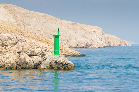 presence: Lighthouse that signals the presence of rocks at passing ships.