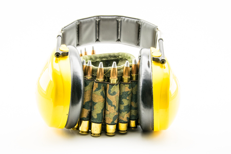 sports shell: yellow ear protection and camouflage ammunition belt for rifle