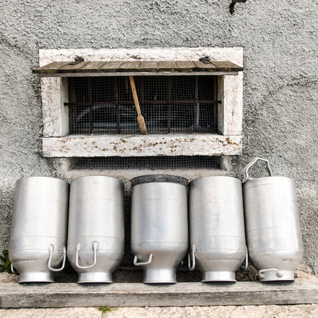milk cans: Vintage milk cans in rural Northern Italy.
