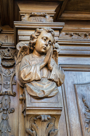 panelled: Detail of a carved wooden portal of an italian church.