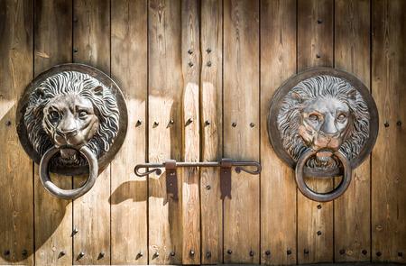 doorknocker: Antique door knocker shaped like a lions head.