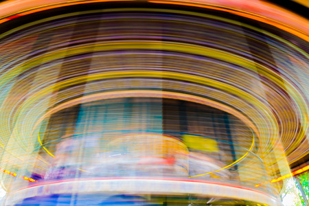 turnabout: Motion blurr of vintage merry-go-round carousel.
