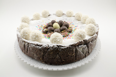 ferrero: Easter cake with ricotta and chocolate decorated with chocolate eggs and powdered sugar Stock Photo